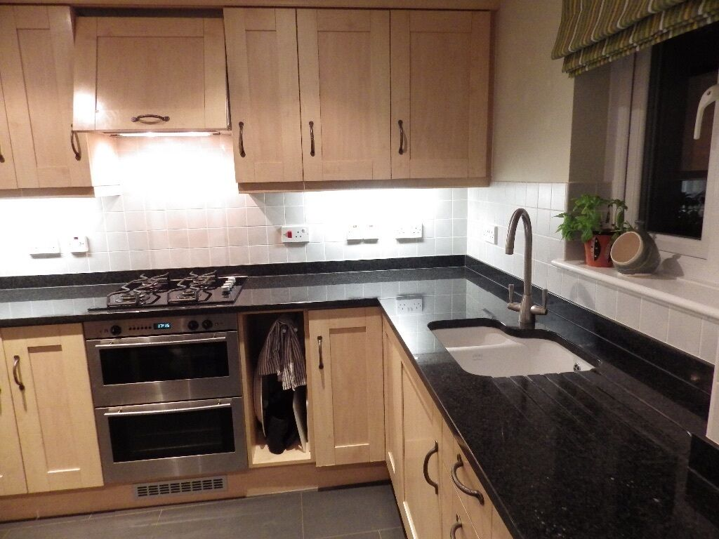 A Beautiful Beech Effect Fitted Kitchen With Black Granite