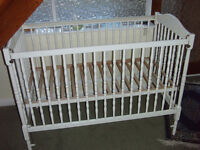 Cot drop-sided white used.In excellent condition including mattress 610mm x 210mm