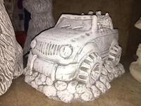 Stone garden ornament jeep