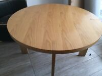 Dwell dining table and four free leather chairs.