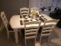 white solid table and 6 chairs + cofe table