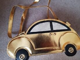 Ladies novelty handbag in the shape of a gold car - unused