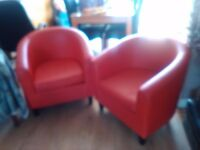 2 red tub chairs
