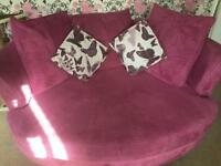 DFS large black sofa , large pink cuddle chair and foot stool
