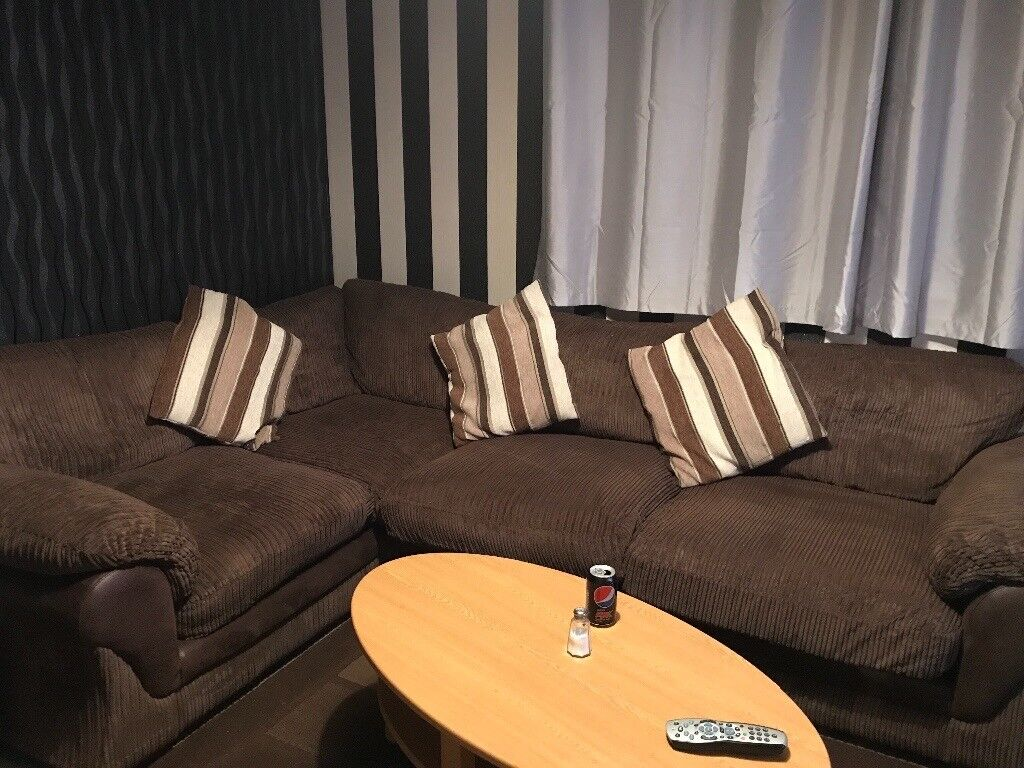 Corner sofa and storage foot stool