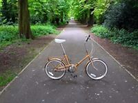 Lovely, inexpensive vintage folding bike. Fully working. 3 speed. Fantastic colour.
