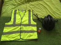 Bicycle helmet, safety lights and safety vest.
