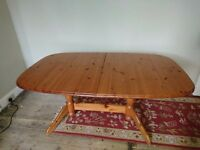Pine table in need of repair to one leg-free collection only