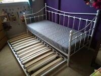 White metal framed girls sleep over bed