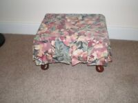 Covered Footstool with wooden base and legs