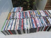 A collection of DVDs for sale ideal for car booting.