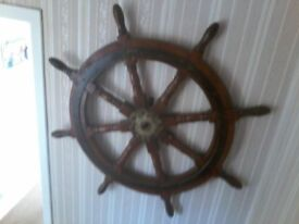 Antique ships wheel, heavy wooden and iron . Would make a brilliant addition to a coastal pub.