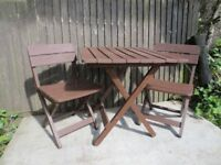 Fold able wooden table and 2 chairs - Also come with 2 cushions