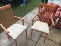 Two orange arm chairs nice a few marks on seats but in good working order