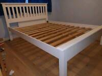 White wooden double bed frame