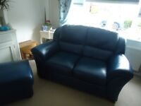Dark Blue Italian leather sofa and foot stool. VGC.