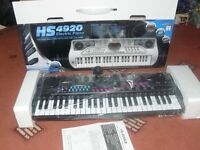 Medium sized keyboard - brand new and boxed with all the accessories. Aged 8 years plus