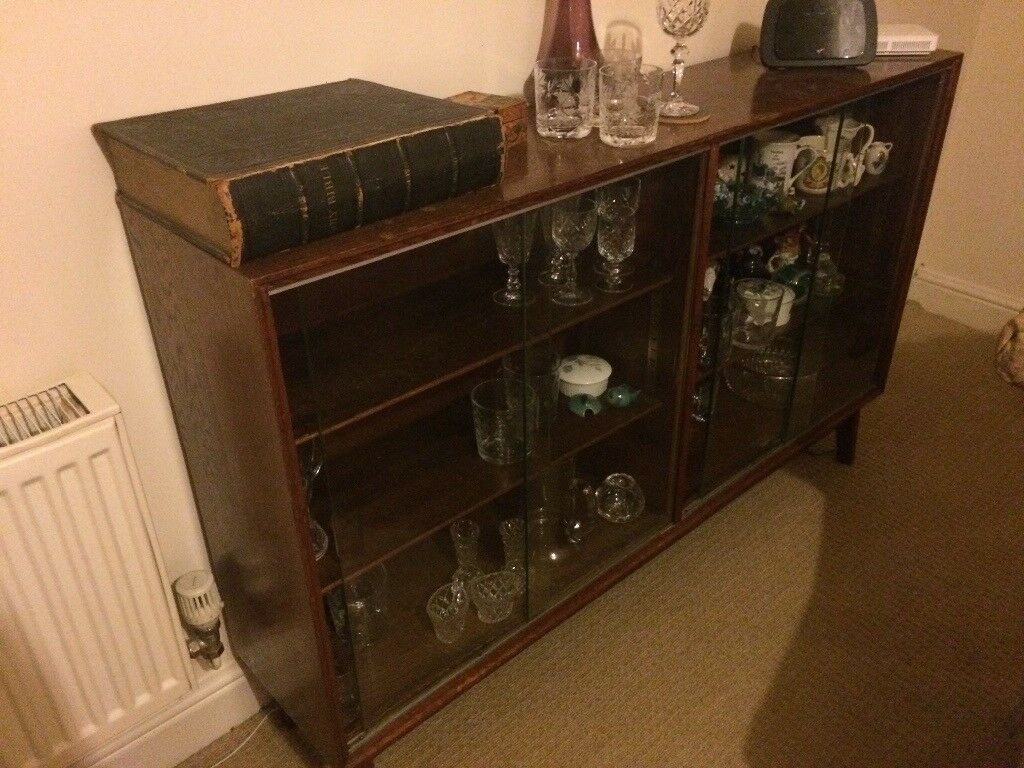 1930's glass display cabinet with sliding doors - good condition