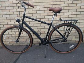 Priority Bicycles city bike with hub gear, mudguards, belt drive and pannier rack