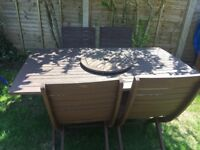 Solid wooden garden table and 4 chairs.