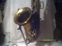 C - MELODY SAXOPHONE by CUESNON of PARIS IN BRASS IN OVERALL GOOD CONDITION , COMPLETE .