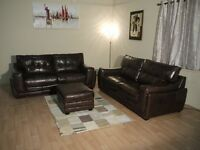 Endurance Marathon brown leather pair of 3 seater sofas and storage footstool