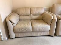 Cream leather sofas and footstool