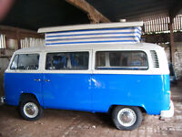 T2 BAY WINDOW POP TOP work in progress and a number of VW T25 's for sale .