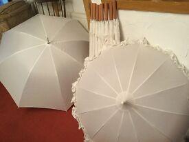 Brides umbrellas--- Brass bedsted---wedding arch