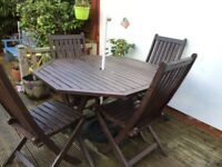 Mahogany garden table and four chairs