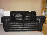 For quick sale- not to be missed - A two seater black genuine leather sofa