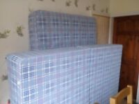 Double bed brand new with mattress.