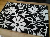Brand new, unused black and ivory rug