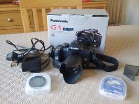 Dmc- g1k panasonic lumix dslr camera with lens ,uv filter, polarising filter and sd card