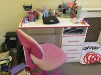 Children's pink desk and chair