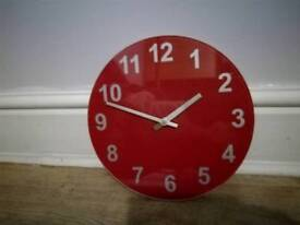 For sale red glass clock with silver hands