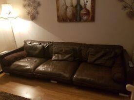 Large leather sofa in chocolate brown.