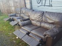 Comfy Used Brown leather 3 and 2 seaters sofas recliners with some wear and tear around.Can deliver