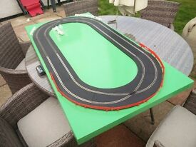 Green Scalextric Oval Circuit with Crossovers on MDF painted board