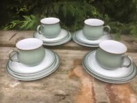 Four Regency Green cups, saucers and side plates.