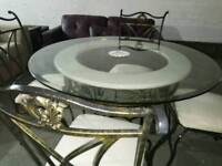 Stunning marble,glass and wrought iron round dinning table with 4 chairs