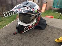Moto cross helmet and pro grip tinted goggles
