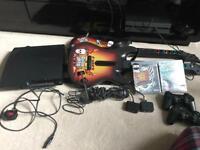 PlayStation 3 Slim - 500GB. 4 controllers + Guitar Hero