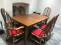A dinning table with 6 chairs