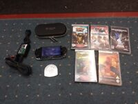 sony psp console with charger, 1 umd movie, 5 games, a case & a memory card with 80 games on it