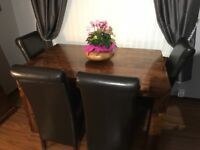 Beautiful solid indian rubberwood table with four dark brown leather chairs