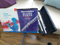flute , stand and lesson books