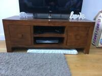 Next Dakota solid mango wood tv unit.