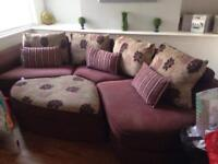 Fabric corner couch with puffy, a purple round rug free £180