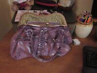2 purple ladies handbags